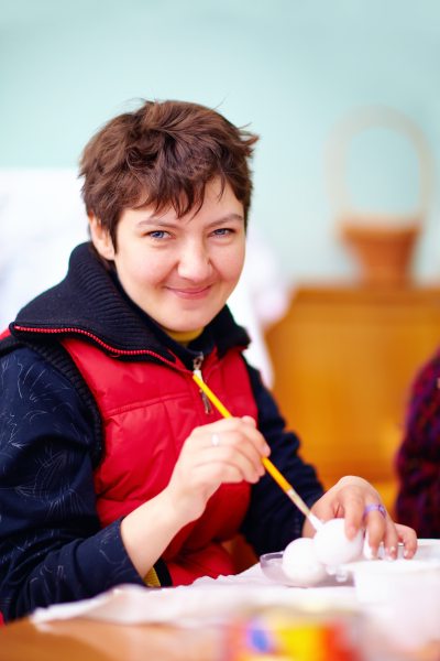 woman with disability engaged in craftsmanship in rehabilitation center