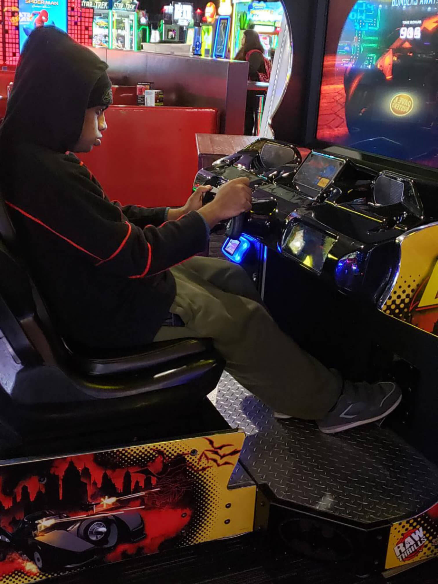 boy playing arcade game